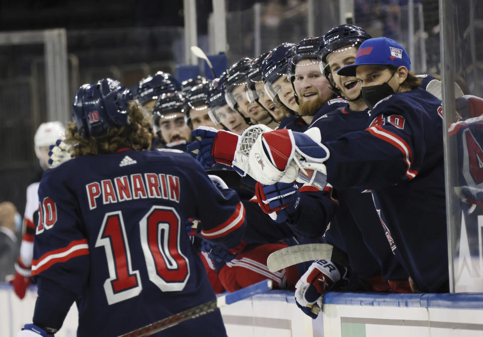 New York Rangers' Artemi Panarin (10) is congratulated for his second-period goal against the New Jersey Devils in an NHL hockey game Thursday, April 15, 2021, in New York. (Bruce Bennett/Pool Photo via AP)