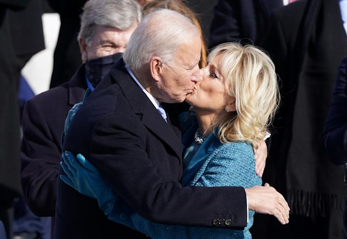 Joe Biden and his wife Jill Biden kiss after he was sworn in as the 46th President of the United States. (Kevin Lamarque/Reuters)