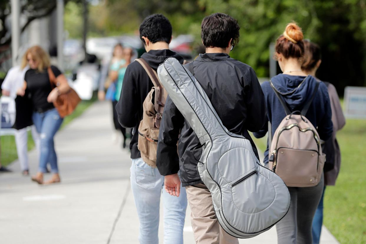 Students walk on the campus of Miami Dade College, in Miami. (AP Photo/Lynne Sladky)