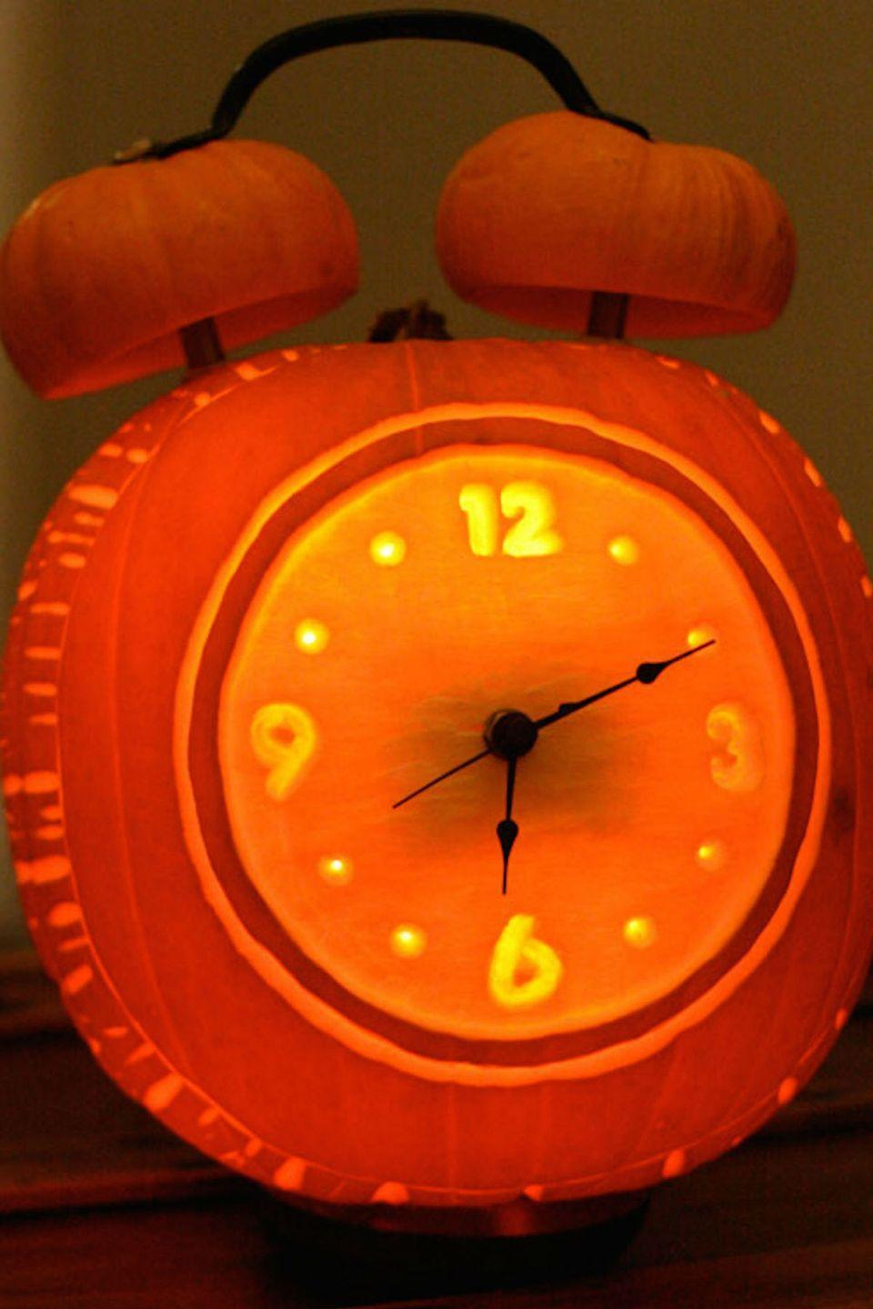 "<p>Count down to midnight with this retro clock carving.</p><p><strong>Get the tutorial at <a href=""http://builtbykids.com/alarm-clock-halloween-pumpkin/"" rel=""nofollow noopener"" target=""_blank"" data-ylk=""slk:Built by Kids"" class=""link rapid-noclick-resp"">Built by Kids</a>. </strong></p>"