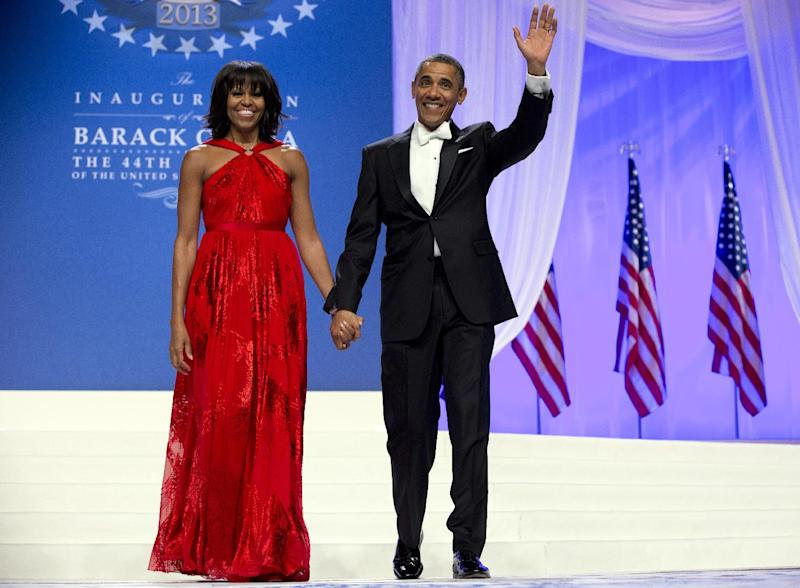 FILE - This Jan. 21, 2013 file photo shows President Barack Obama and first lady Michelle Obama at an Inaugural Ball at the Washington Convention Center in Washington, during the 57th Presidential Inauguration. Nobody would call bangs a new trend, but when the first lady's involved, things take on more significance. In fact, President Barack Obama did call his wife Michelle's new hairdo the most significant event of his second inauguration. (AP Photo/Carolyn Kaster, File)