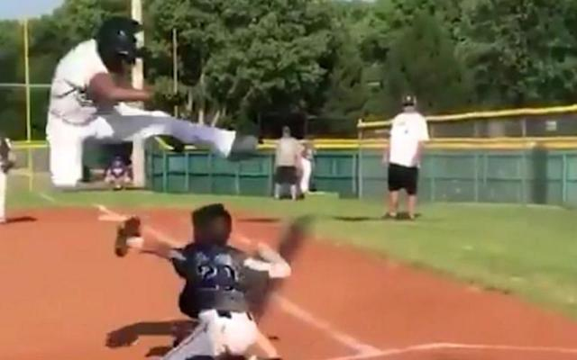 Little Leaguer Mason Cherry goes airborne to score a wild run. (@WarriorsB8sball on Twitter)