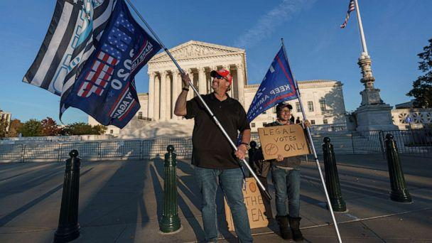PHOTO: While waiting for a result in the election, Scott Knuth of Woodbridge, Va., and Christy Pheagin, of Washington, stand outside the Supreme Court in Washington, Nov. 6, 2020. (J. Scott Applewhite/AP)