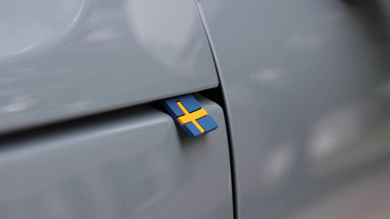 "<p>What is the Swedish flag doing sticking out from where the XC40's clamshell hood and fender meet? As far as I can tell, the little rubber flag is like a tag on a pair of designer jeans, meant to aggressively whisper your uniqueness to those who would notice. ""Oh, your luxury subcompact SUV doesn't have a tag?"" is what you say back at them with your eyes. </p>"