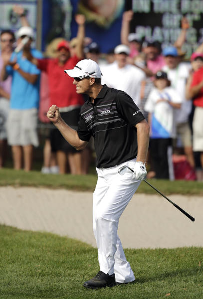 John Senden, of Australia, reacts after chipping in on the 16th hole during the final round of the Valspar Championship golf tournament at Innisbrook, Sunday, March 16, 2014, in Palm Harbor, Fla. Senden won the tournament. (AP Photo/Chris O'Meara)