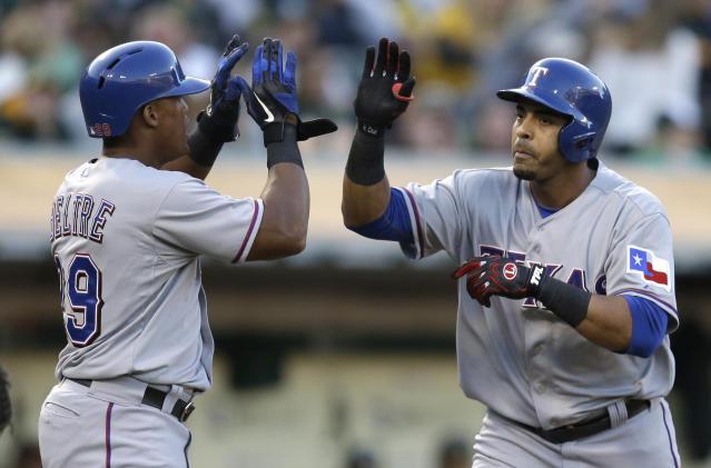 Texas Rangers' Nelson Cruz, right, is congratulated by Adrian Beltre after Cruz hit a two run home run off Oakland Athletics' Tommy Milone in the second inning of a baseball game, Friday, Aug. 2, 2013, in Oakland, Calif. (AP Photo/Ben Margot)