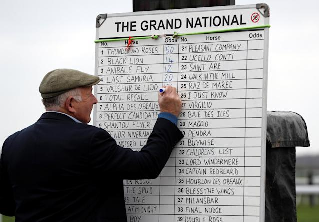 Horse Racing - Grand National Festival - Aintree Racecourse, Liverpool, Britain - April 14, 2018 A bookmaker writes down the odds for the grand national race REUTERS/Darren Staples