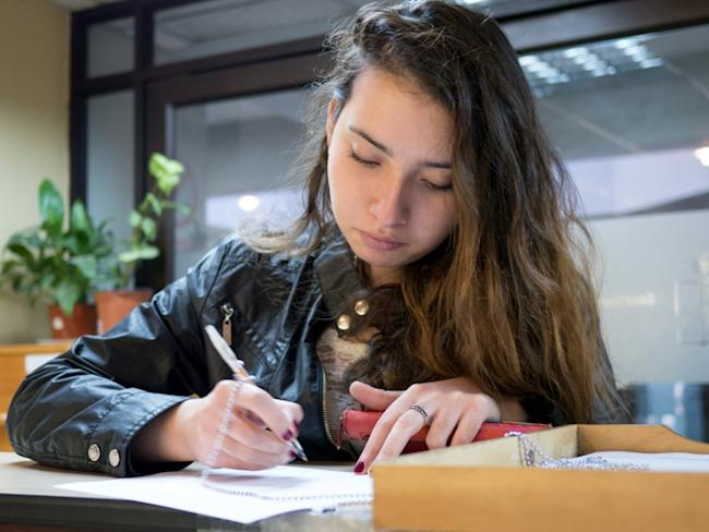 young woman writing