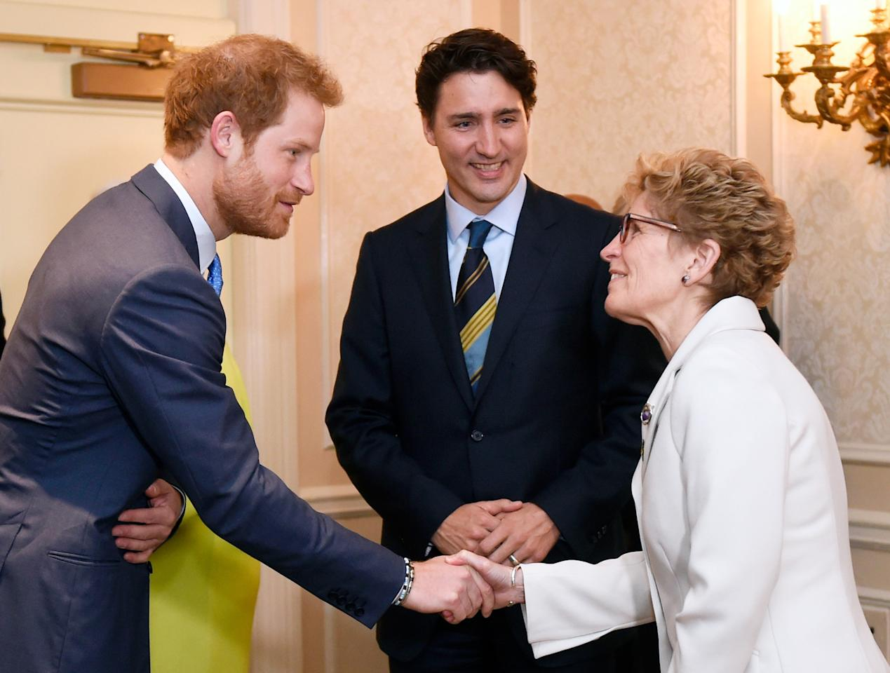 Prince Harry shakes hands with Ontario Premier Kathleen Wynne (R), as Prime Minister Justin Trudeau looks on during the Prince's visit to Toronto to promote the 2017 Invictus Games, which the city will be hosting, on Monday, May 2, 2016. REUTERS/Nathan Denette/Pool