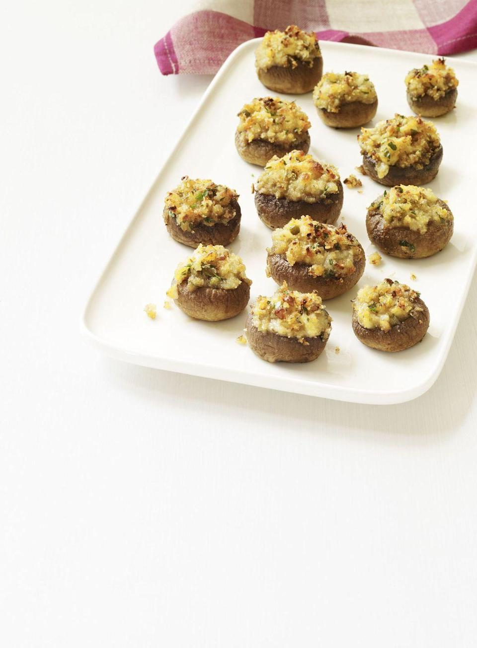 """<p>The secret ingredient that makes these bite-sized shrooms so flavorful isn't the white wine or the lemon juice — it's the minced clams.</p><p><a href=""""https://www.womansday.com/food-recipes/food-drinks/recipes/a11418/stuffed-mushrooms-recipe-wdy1113/"""" rel=""""nofollow noopener"""" target=""""_blank"""" data-ylk=""""slk:Get the Stuffed Mushrooms recipe."""" class=""""link rapid-noclick-resp""""><em><strong>Get the Stuffed Mushrooms recipe.</strong></em></a></p>"""