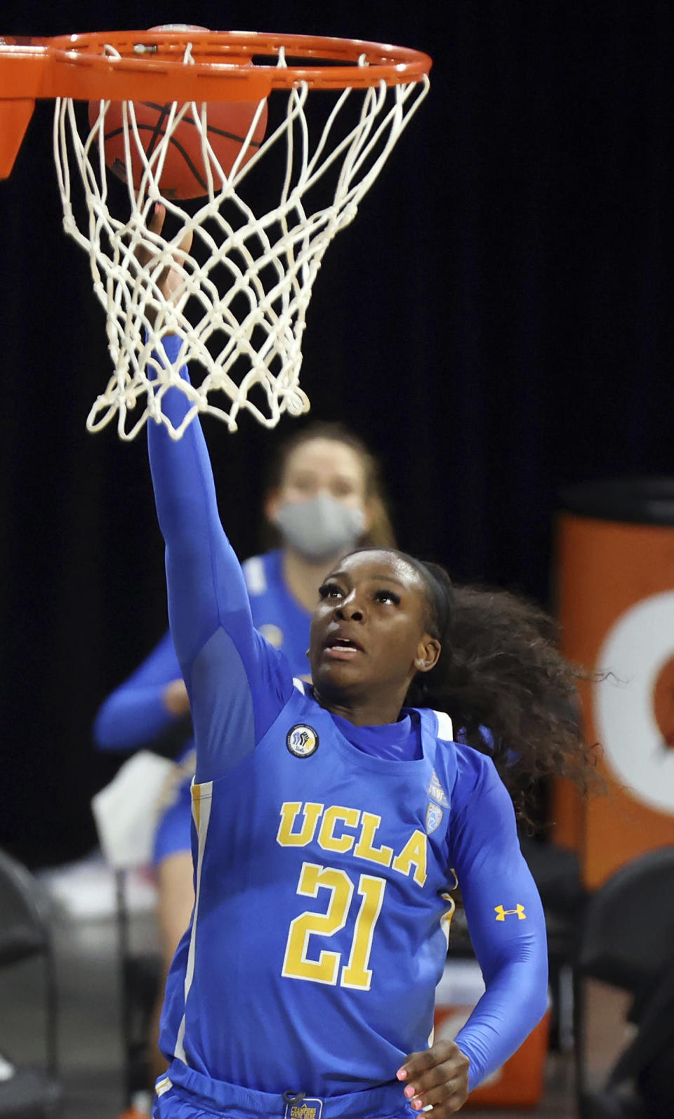UCLA forward Michaela Onyenwere shoots during the second half of the team's NCAA college basketball game against Arizona in the semifinals of the Pac-12 women's tournament Friday, March 5, 2021, in Las Vegas. (AP Photo/Isaac Brekken)