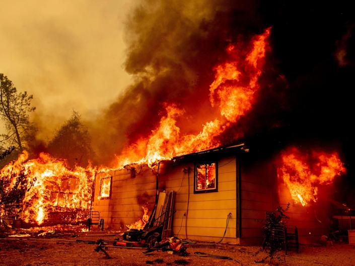 Flames consume a house near Old Oregon Trail as the Fawn Fire burns about 10 miles north of Redding in Shasta County, Calif., on Thursday, Sep. 23, 2021.