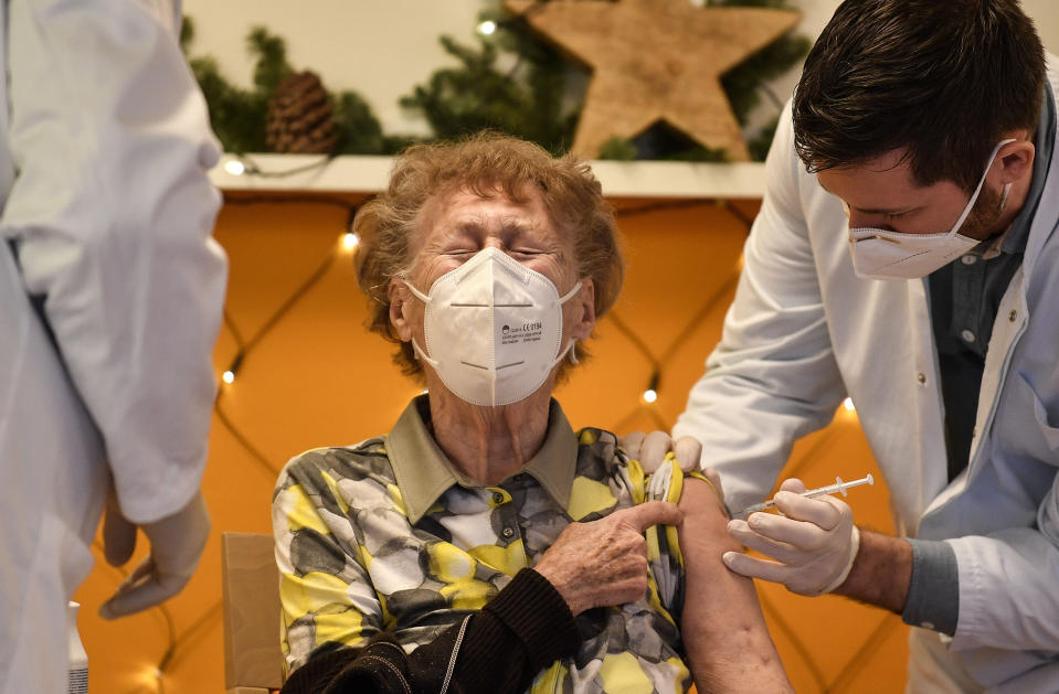 FILE - In this Sunday, Dec. 27, 2020 file photo, a resident of a nursing home gets an injection of the COVID-19 vaccine in Cologne, Germany. Thousands of elderly Germans faced online error messages and jammed up hotlines Monday Jan. 25, 2021, as technical problems marred the start of the coronavirus vaccine campaign for over-80s in the country's most populous state. (AP Photo/Martin Meissner, File)