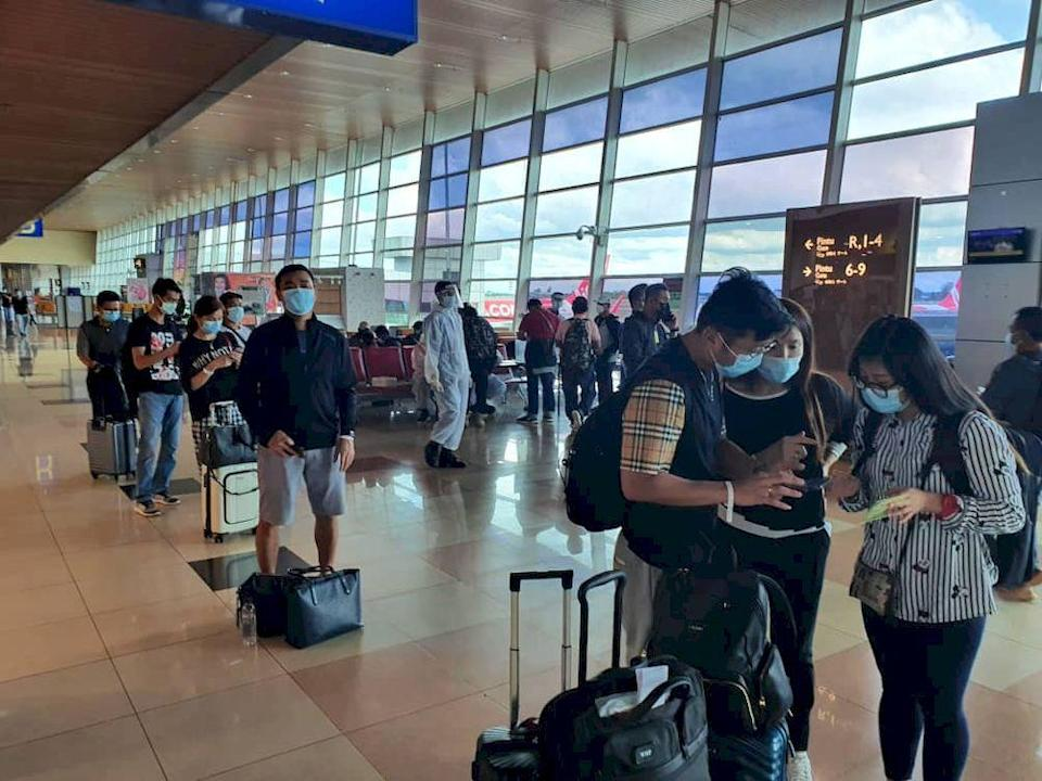 The group of 68 Sarawakians upon their arrival at the Kuching International Airport before they were taken to the quarantine centres, March 16, 2021. — Picture courtesy of the state Ministry of Transport