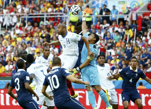 Soccer players of France and Honduras (in white) fight for the ball during their 2014 World Cup Group E soccer match at the Beira-Rio stadium in Porto Alegre June 15, 2014. REUTERS/Murad Sezer (BRAZIL - Tags: SOCCER SPORT WORLD CUP)