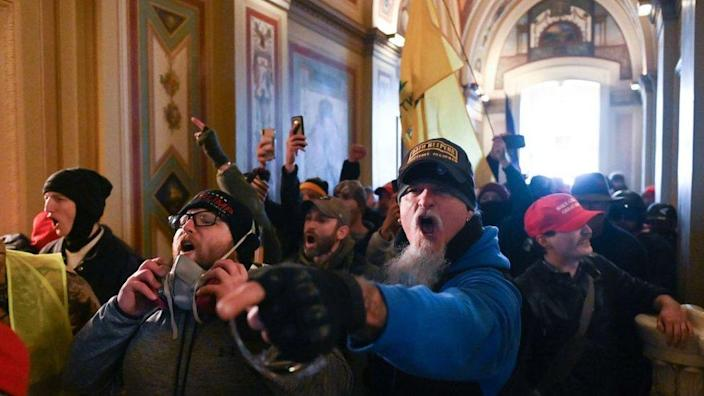 Supporters of US President Donald Trump protest inside the US Capitol on January 6, 2021, in Washington, DC
