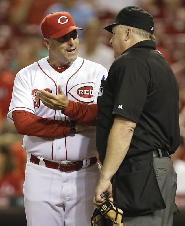 Cincinnati Reds manager Bryan Price (38) argues a called third strike against Kris Negron with home plate umpire Bill Miller in the fifth inning of a baseball game against the Chicago Cubs, Tuesday, Aug. 26, 2014, in Cincinnati. (AP Photo/Al Behrman)