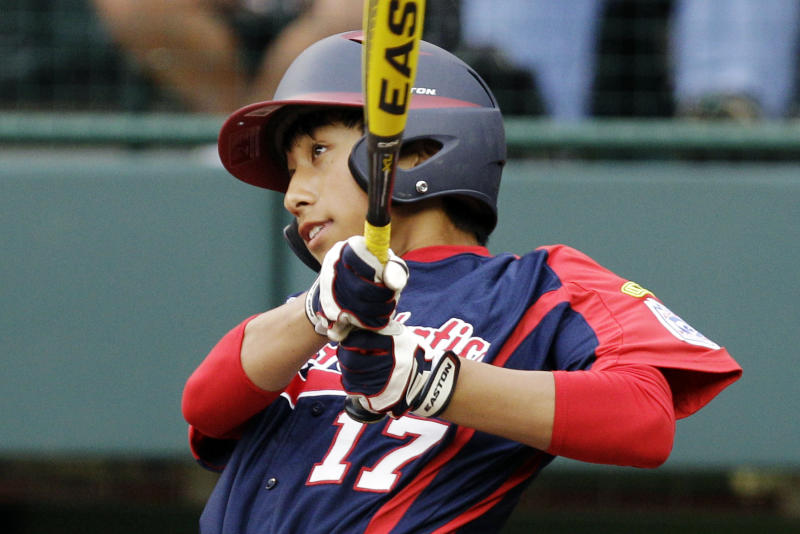 Parsippany, N.J.'s Emil Matti (17) hits a solo home run off Petaluma, Calif., pitcher Bradley Smith in the sixth inning of an elimination baseball game at the Little League World Series tournament in South Williamsport, Pa., Monday, Aug. 20, 2012. Petaluma won 5-4 in eight innings. (AP Photo/Gene J. Puskar)