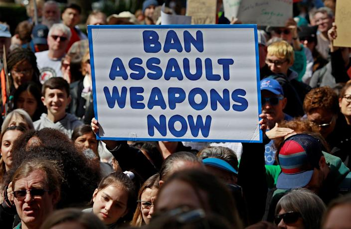 "A protestor holds a sign during a ""March For Our Lives"" demonstration demanding gun control in Sacramento, California, U.S. March 24, 2018."