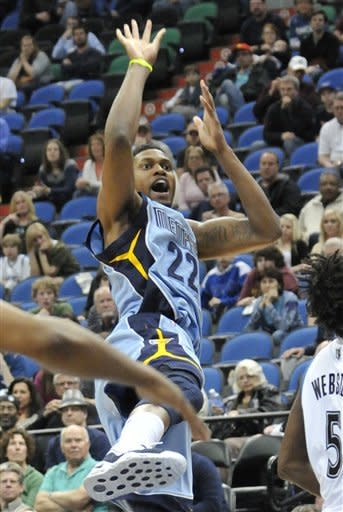 Memphis Grizzlies' Rudy Gay (22) follows through with a shot in the second half of an NBA basketball game against the Minnesota Timberwolves Tuesday, April 17, 2012, in Minneapolis. Gay led the Grizzlies with 28 points in their 91-84 win. (AP Photo/Jim Mone)