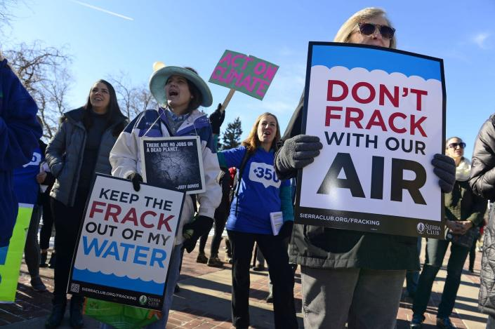 "<span class=""caption"">Protesters rally to have Colorado's then-incoming governor put an up-to-nine-month moratorium on oil and gas development.</span> <span class=""attribution""><a class=""link rapid-noclick-resp"" href=""https://www.gettyimages.com/detail/news-photo/from-left-to-right-sandy-tolland-in-hat-miranda-glasbergen-news-photo/1076896552?adppopup=true"" rel=""nofollow noopener"" target=""_blank"" data-ylk=""slk:Helen H. Richardson/The Denver Post via Getty Images"">Helen H. Richardson/The Denver Post via Getty Images</a></span>"