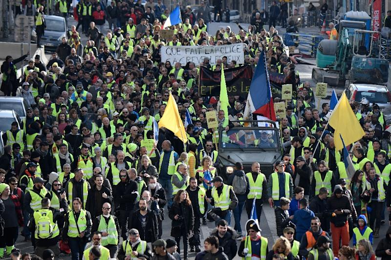 'Yellow vest' protesters turned out again in the French Mediterranean city of Marseille, joining thousands of others across the country (AFP Photo/GERARD JULIEN)