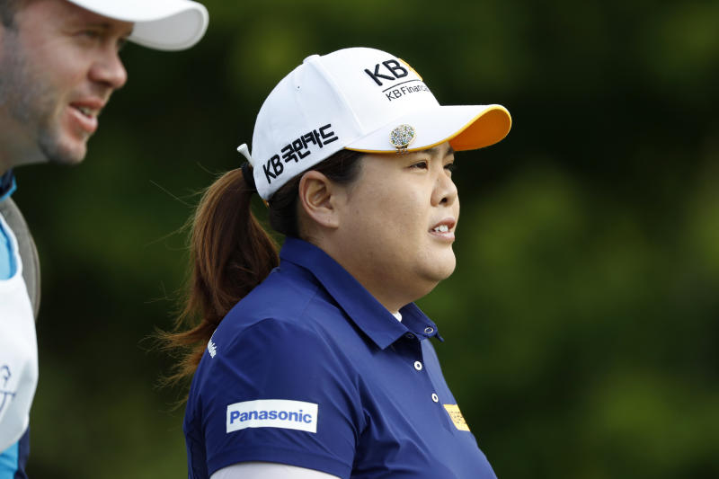 Inbee Park, of South Korea, walks off the 10th tee during the first round of the KPMG Women's PGA Championship golf tournament, Thursday, June 20, 2019, in Chaska, Minn. (AP Photo/Charlie Neibergall)