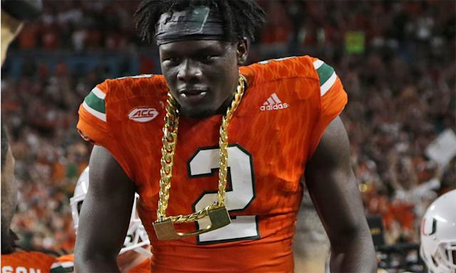 Miami defensive back Trajan Bandy wears the turnover chain after returning an interception for a touchdown during the first half of an NCAA college football game against Notre Dame, Saturday, Nov. 11, 2017, in Miami Gardens, Fla. (AP Photo/Lynne Sladky)