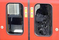 <p>Armed police officers walk through a carriage of the affected Tube train on Friday morning. (AP) </p>