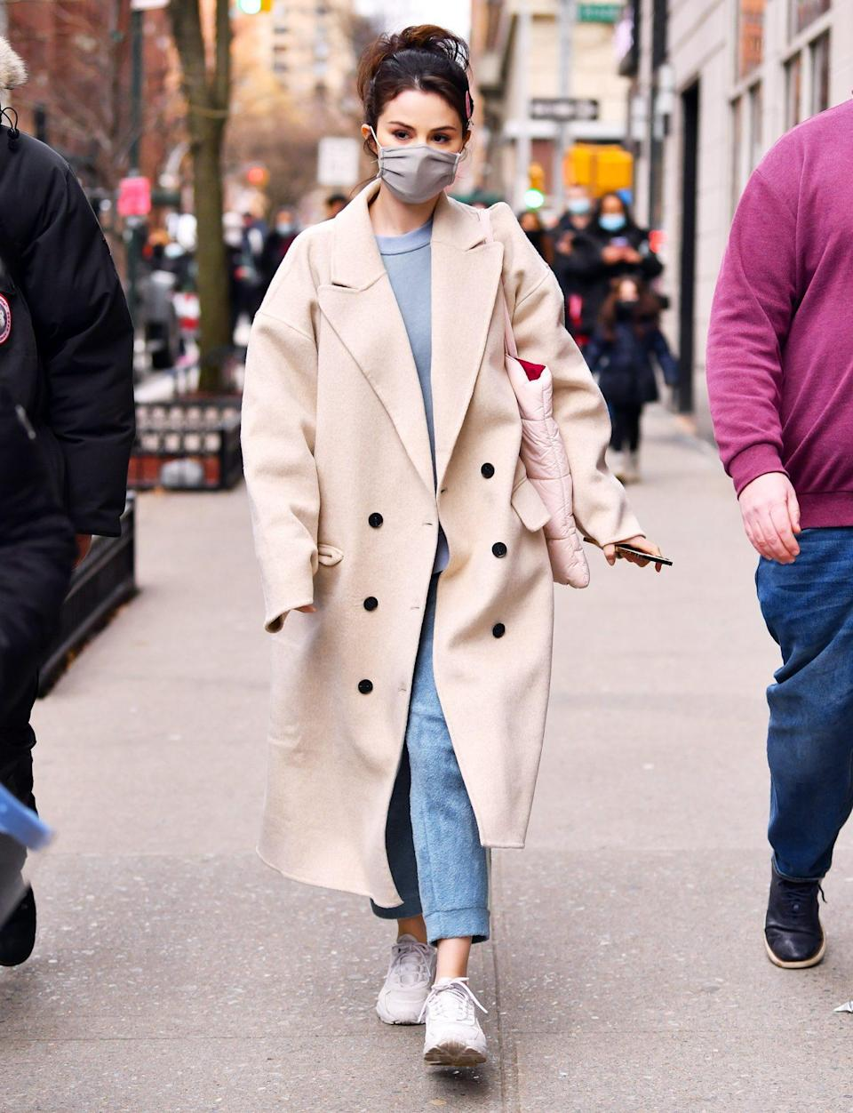 <p>Selena Gomez makes the sidewalk her catwalk in New York City on Sunday.</p>