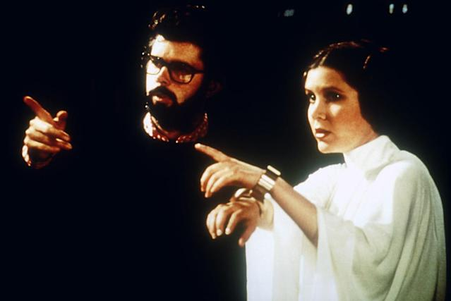 George Lucas directs Carrie Fisher on the set of <em>A New Hope</em>. (Photo: Everett Collection)