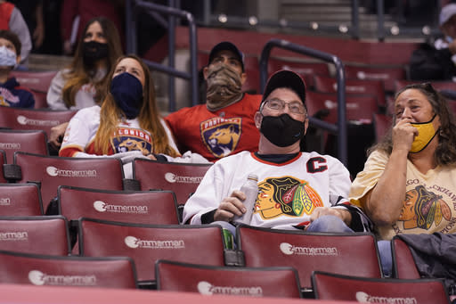 Fans watch the second period of an NHL hockey game between the Florida Panthers and the Chicago Blackhawks on Tuesday, Jan. 19, 2021, in Sunrise, Fla. Not only are the Panthers still unbeaten after two games but theyre also leading the NHL in attendance. (AP Photo/Marta Lavandier)