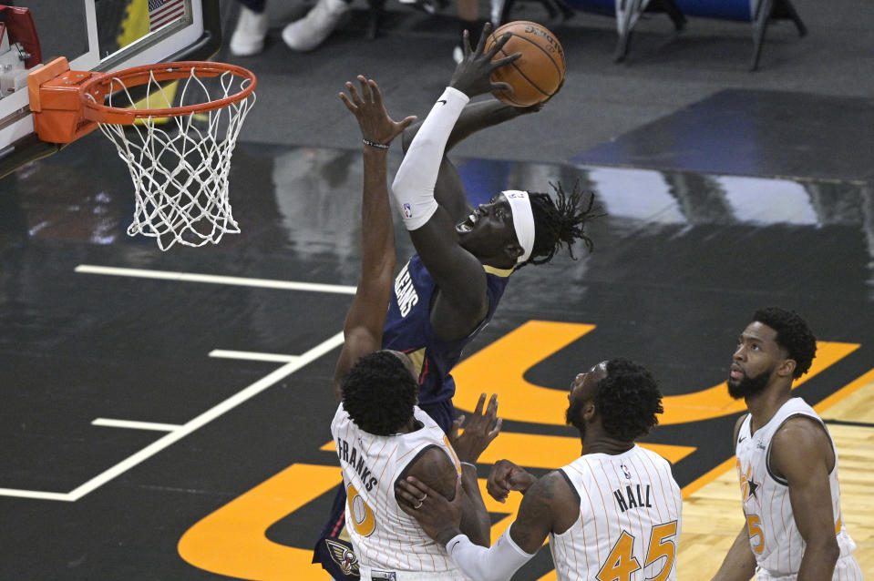 New Orleans Pelicans forward Wenyen Gabriel goes up for a shot in front of Orlando Magic forward Robert Franks (0), forward Donta Hall (45) and guard Chasson Randle, right, during the second half of an NBA basketball game Thursday, April 22, 2021, in Orlando, Fla. (AP Photo/Phelan M. Ebenhack)