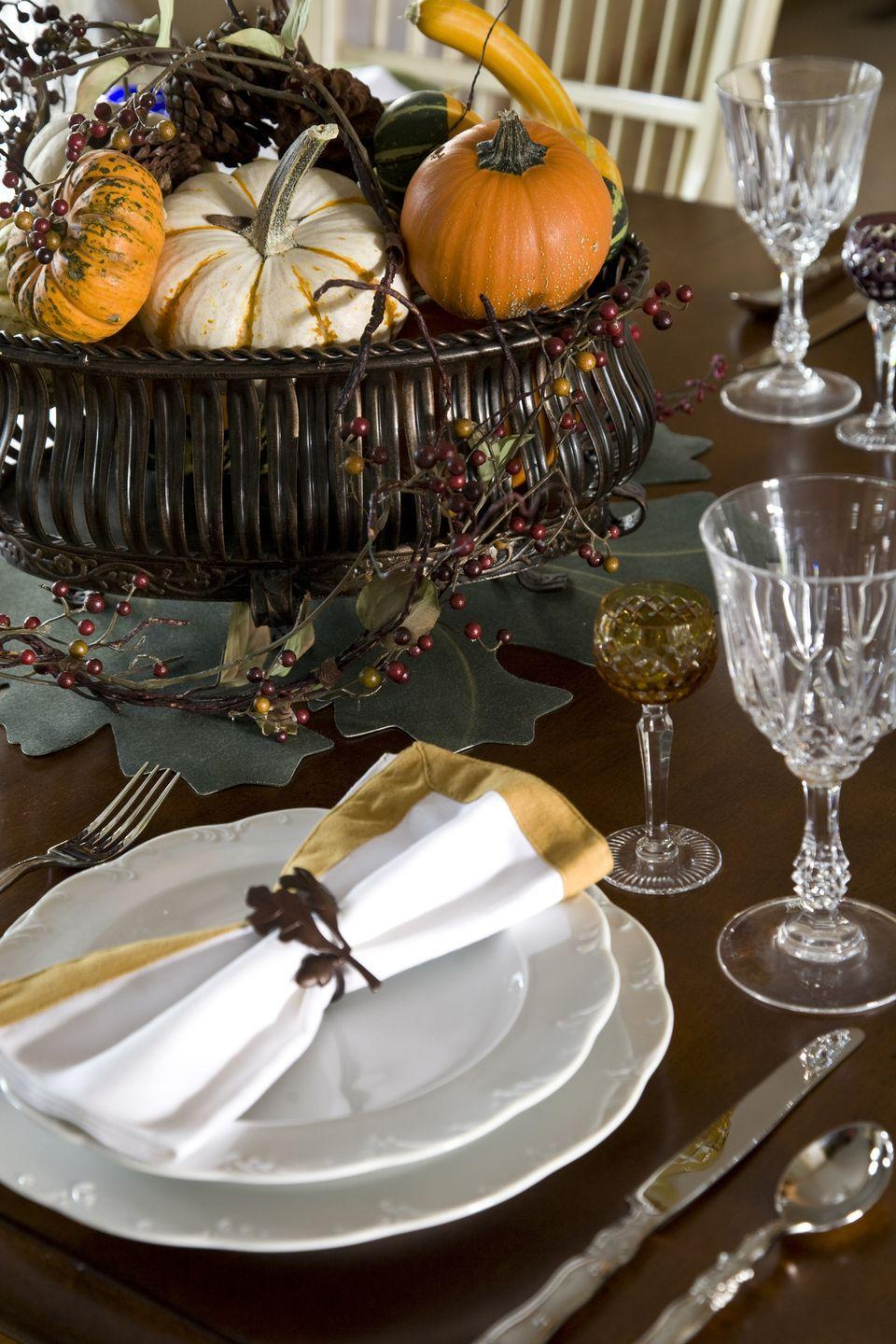 <p>Set a cheery mix of pumpkins and gourds in an elevated bowl for a no-fail fall centerpiece. </p>