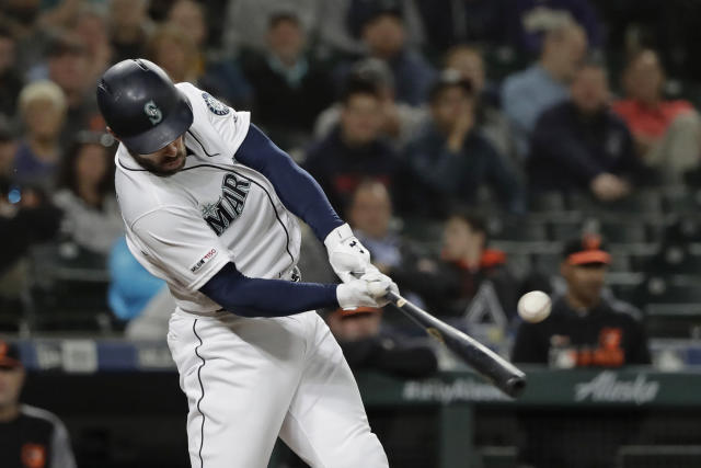 Seattle Mariners' Mac Williamson hits an RBI single against the Baltimore Orioles during the sixth inning of a baseball game Thursday, June 20, 2019, in Seattle. (AP Photo/Ted S. Warren)