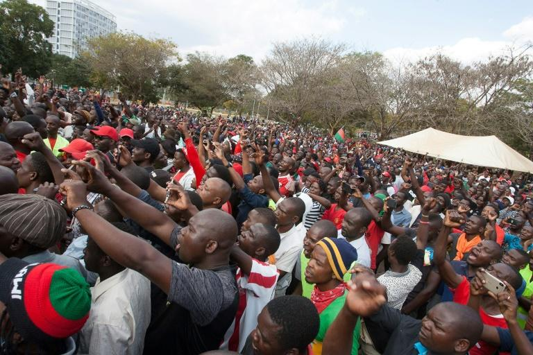 Malawi opposition supporters march to the parliament during a demonstration against the re-election of the president, which protestors say was due to fraud, on July 4, 2019, in Lilongwe, Malawi