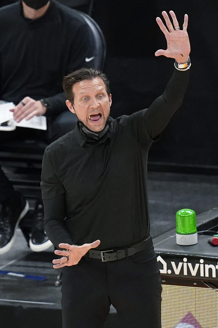 Utah Jazz coach Quin Snyder shouts to the team during the first half of an NBA basketball game against the Atlanta Hawks on Friday, Jan. 15, 2021, in Salt Lake City. (AP Photo/Rick Bowmer)