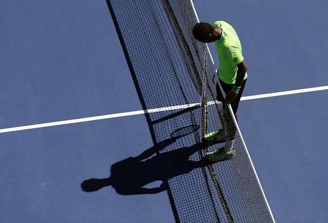 Gael Monfils, of France, stands at the net between points against Alejandro Gonzalez, of Colombia, during the second round of the 2014 U.S. Open tennis tournament, Friday, Aug. 29, 2014, in New York. (AP Photo/Elise Amendola)