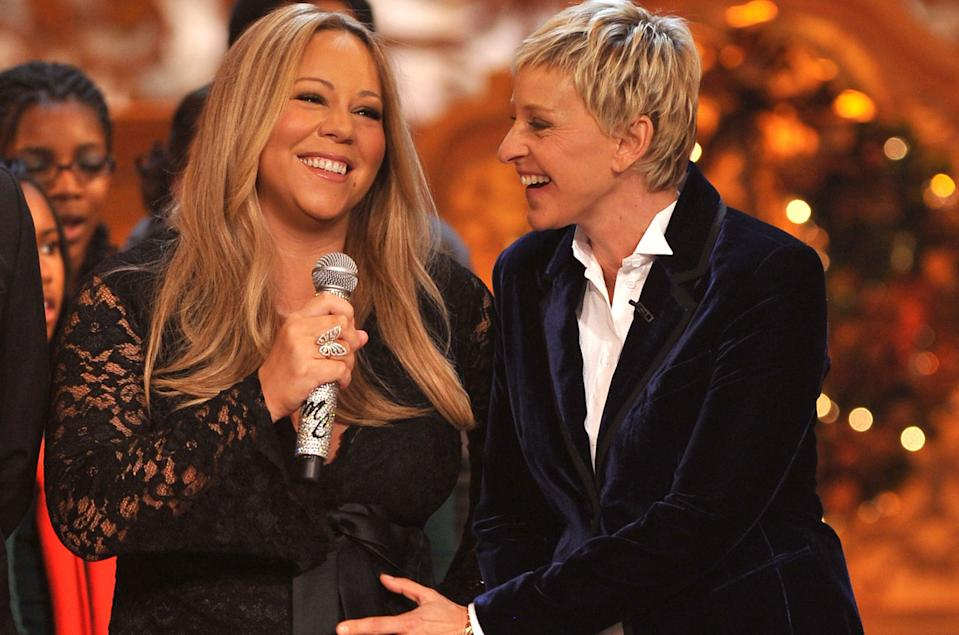 Mariah Carey and Ellen DeGeneres at a Christmas event in 2010. (Getty Images)