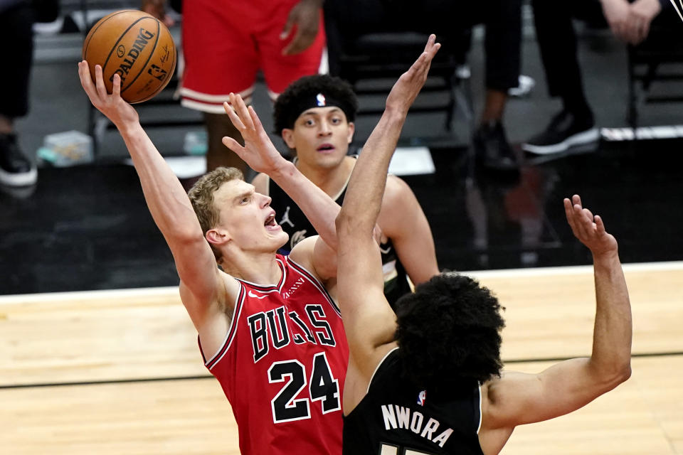 FILE - Chicago Bulls forward Lauri Markkanen, left, shoots against Milwaukee Bucks forward Jordan Nwora during the second half of an NBA basketball game in Chicago, in this Sunday, May 16, 2021, file photo. The Cavaliers have agreed to acquire restricted free agent forward Lauri Markkanen from Chicago in a three-way trade that will send forward Larry Nance Jr. from Cleveland to Portland, a person familiar with the deal told the Associated Press on Friday, Aug. 27, 2021. (AP Photo/Nam Y. Huh, File)