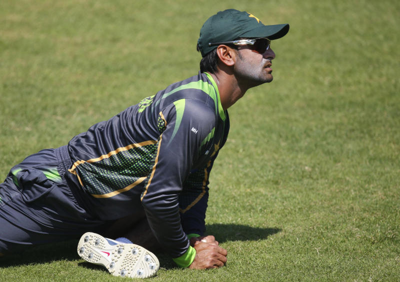 Pakistan captain Mohammad Hafeez does stretching exercises during a training session ahead of their ICC Twenty20 Cricket World Cup match against Bangladesh in Dhaka, Bangladesh, Saturday, March 29, 2014. (AP Photo/Aijaz Rahi)