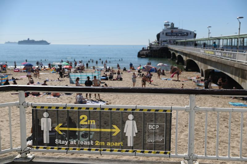A social distance sign during the hot weather on Bournemouth beach in Dorset.