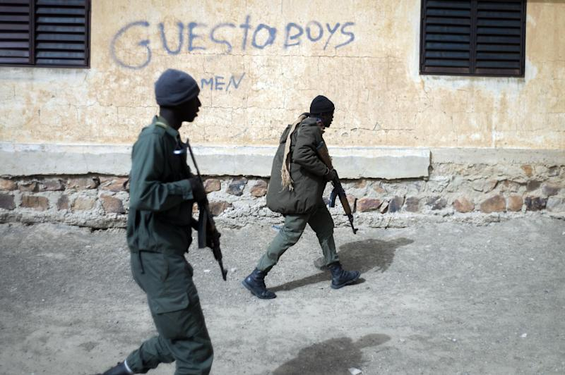 Malian soldiers patrol in the streets of Timbuktu on February 1, 2013 as French-led troops work to secure the last Islamist stronghold in the north