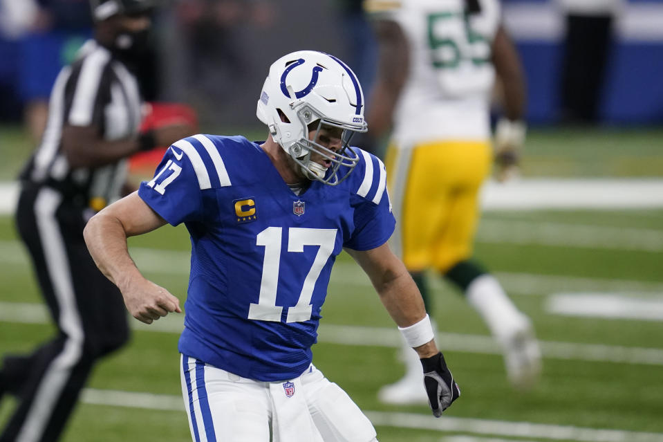 Indianapolis Colts quarterback Philip Rivers (17) reacts after throwing a touchdown pass during the first half of an NFL football game against the Green Bay Packers, Sunday, Nov. 22, 2020, in Indianapolis. (AP Photo/Michael Conroy)