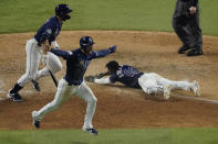 Tampa Bay Rays' Randy Arozarena celebrates after scoring the winning run in Game 4 of the baseball World Series against the Los Angeles Dodgers Saturday, Oct. 24, 2020, in Arlington, Texas. Rays defeated the Dodgers 8-7 to tie the series 2-2 games. (AP Photo/Sue Ogrocki)