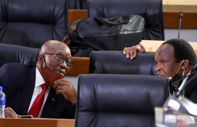 FILE PHOTO: South Africa's former president, Jacob Zuma, chats with a member of his legal team ahead of the commission of inquiry probing state capture, in Johannesburg