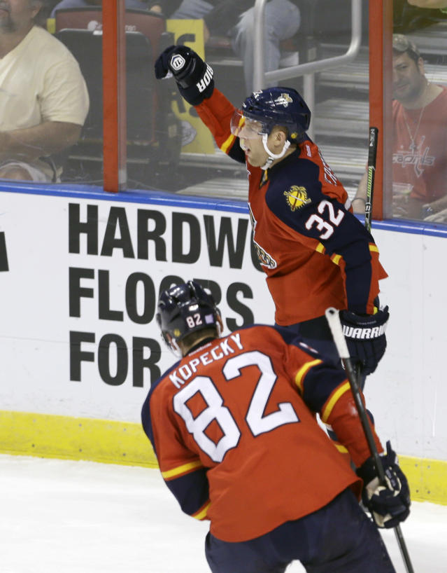 Florida Panthers right wing Kris Versteeg (32) celebrates after scoring against the Boston Bruins in the second period of an NHL hockey game, Thursday, Oct. 17, 2013, in Sunrise, Fla. (AP Photo/Alan Diaz)