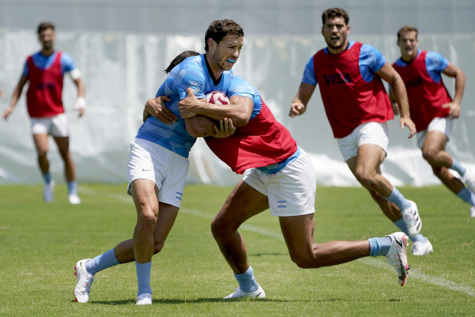 Argentina's Lucio Cinti, right, tackles Franco Sabato during a men's rugby sevens practice at the Tokyo 2020 Olympics, in Tokyo, Friday, July 23, 2021. (AP Photo/David Goldman)