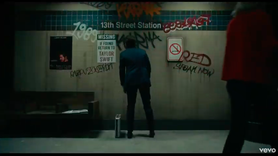 """<p>Swift's favorite number is 13, but there's a lot of other symbolism to unpack in this shot of the 13th street station. Swift included the names of her first six albums (Red, 1989, and Speak Now the most clearly, although Taylor Swift is visible too) along with a no scooter sign. That no scooter sign is likely a nod to producer Scooter Braun, who acquired the masters to those first six albums with his acquisition of Big Machine Label this summer. </p><p>Swift <a href=""""https://www.elle.com/culture/celebrities/a28234622/taylor-swift-scooter-braun-letter-tumblr/"""" target=""""_blank"""">wrote an open letter</a> when the news came out, describing Braun owning the masters as her """"worst case scenario"""" because of """"the incessant, manipulative bullying I've received at his hands for years.""""</p>"""