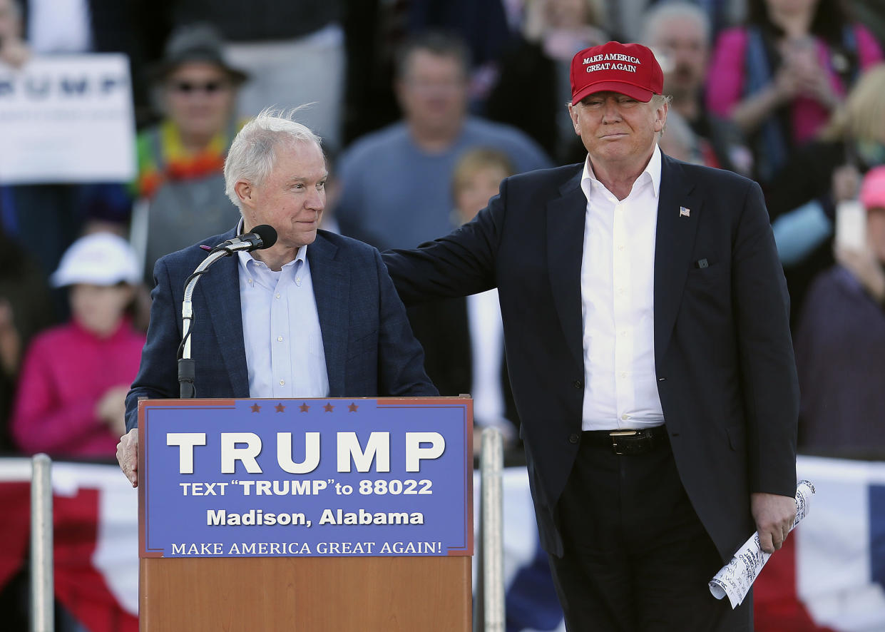 Trump stands next to then-Sen. Jeff Sessions, R-Ala., at a rally in Madison, Ala., on Feb. 28, 2016. (AP Photo/John Bazemore, File)
